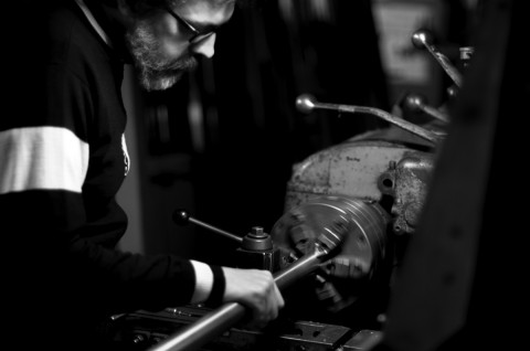 Seven Mike Salvatore at cutoff lathe - photo - Kirk Tegelaar